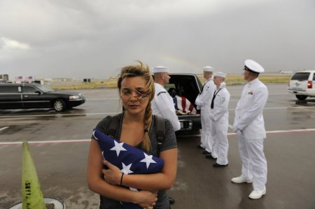 Jonathan-Blunk-26-his-flag-draped-casket-returns-home-to-Reno-Nevada.-He-was-a-five-year-navy-veteran-and-will-receive-full-military-honors