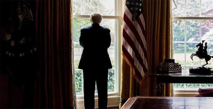 This image has an empty alt attribute; its file name is trump-looking-out-window-oval-office-2-1.jpg